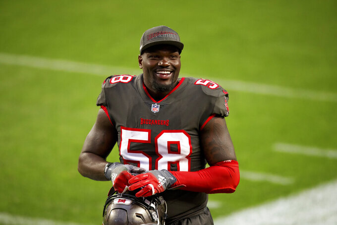 Tampa Bay Buccaneers linebacker Shaquil Barrett (58) smiles while running off the field after defeating the Denver Broncos in an NFL football game, Sunday, Sept.. 27, 2020, in Denver. (AP Photo/Justin Edmonds)