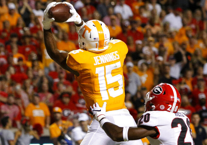 Tennessee wide receiver Jauan Jennings (15) pulls in a 12-yard touchdown against Georgia defensive back J.R. Reed (20) at Neyland Stadium on Saturday, Oct. 5, 2019 in Knoxville, Tenn.(C.B. Schmelter/Chattanooga Times Free Press via AP)