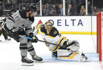 Boston Bruins goaltender Tuukka Rask, right, stops a shot by Los Angeles Kings center Anze Kopitar during the second period of an NHL hockey game Saturday, Feb. 16, 2019, in Los Angeles. (AP Photo/Mark J. Terrill)