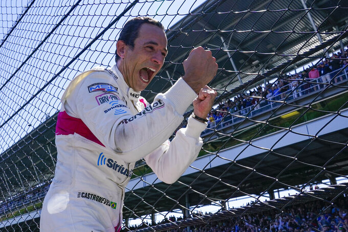 Helio Castroneves of Brazil celebrates after winning the Indianapolis 500 auto race at Indianapolis Motor Speedway in Indianapolis, Monday, May 31, 2021. (AP Photo/Paul Sancya)