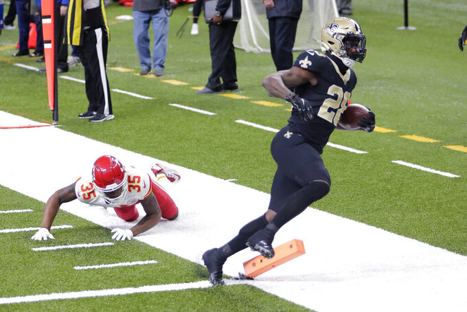 New Orleans Saints running back Latavius Murray (28) scores on a touchdown reception against Kansas City Chiefs cornerback Charvarius Ward (35) in the second half of an NFL football game in New Orleans, Sunday, Dec. 20, 2020. (AP Photo/Brett Duke)