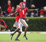 Georgia wide receiver George Pickens celebrates his touchdown catch against Auburn during the first half of an NCAA college football game Saturday, Oct. 3, 2020, in Athens, Ga. (Curtis Compton/Atlanta Journal-Constitution via AP)