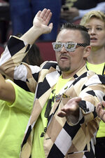 A Purdue fan cheers before the men's NCAA Tournament college basketball South Regional final game between Purdue and Virginia, Saturday, March 30, 2019, in Louisville, Ky. (AP Photo/Timothy D. Easley)
