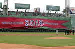 The 2018 World Series Champions banner is unfurled on the Green Monster left field wall of Fenway Park before the home opener baseball game between the Red Sox and the Toronto Blue Jays, Tuesday, April 9, 2019, in Boston. (AP Photo/Charles Krupa)