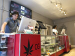 In this Wednesday, March 6, 2019 photo, Korbin Osborn, left, works as a cannabis adviser at a medical marijuana dispensary in Santa Fe, N.M. New Mexico took a step toward legalizing recreational marijuana when its House approved a bill that would allow state-run stores and require customers to carry a receipt with their cannabis or face penalties. The measure, narrowly approved Thursday, March 7, 2019, following a late-night floor debate, mixes major provisions of a Republican-backed Senate bill that emphasizes aggressive regulation with a draft by Democrats concerned about the U.S. war on drugs. (AP Photo/Morgan Lee)