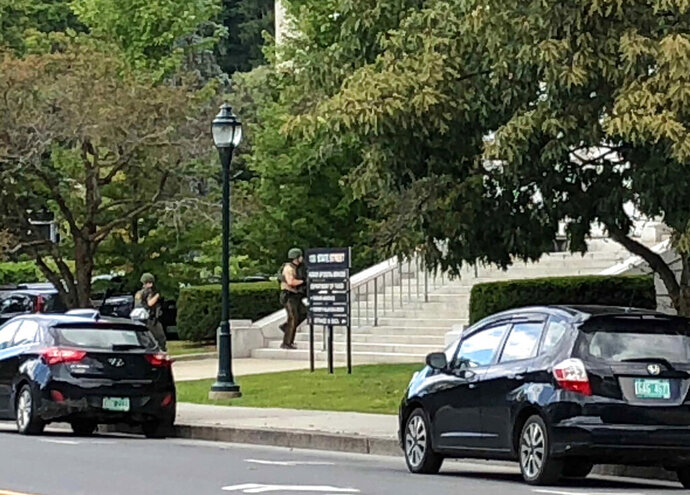 Police cars block off State Street in Montpelier, Vt., where state office buildings are in lockdown on Friday, Aug. 30, 2019.   Some state government buildings are on lockdown in Vermont's Capitol complex after a report of a person with a weapon. State buildings Commissioner Christopher Cole tells WCAX News that there was a report from a member of the public that someone was seen going into the building that houses the tax department with what appeared to be a long gun. (AP Photo/Lisa Rathke)
