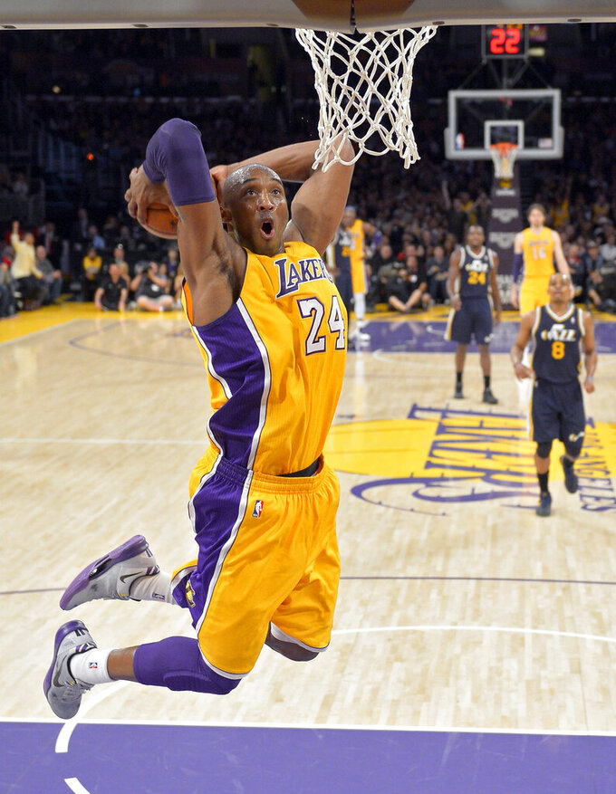 FILE - Los Angeles Lakers guard Kobe Bryant goes up for a dunk during the first half of an NBA basketball game against the Utah Jazz in Los Angeles, in this Friday, Jan. 25, 2013, file photo. Bryant is the game's fourth-leading scorer. He spent 20 years with the Los Angeles Lakers, 18 as an All-Star, and won five titles. Then came the helicopter crash in the fog-shrouded California hills that reverberated across sports and across continents. (AP Photo/Mark J. Terrill, File)
