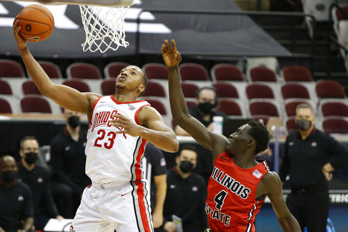 Ohio State's Zed Key, left, shoots past Illinois State's Abdou Ndiaye during the second half of an NCAA college basketball game Wednesday, Nov. 25, 2020, in Columbus, Ohio. Ohio State beat Illinois State 94-67. (AP Photo/Jay LaPrete)