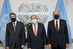 In this photo provided by the United Nations, Secretary General Antonio Guterres, center, meets Greek Cypriot Leader Nicos Anastasiades, left, and Turkish Cypriot Leader Ersin Tatar, at U.N. headquarters, Monday, Sept. 27, 2021. (Mark Garten/U.N. via AP)