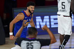 Denver Nuggets' Jamal Murray reacts after a basket during the second half of an NBA conference semifinal playoff basketball game against the Los Angeles Clippers, Friday, Sept. 11, 2020, in Lake Buena Vista, Fla. (AP Photo/Mark J. Terrill)