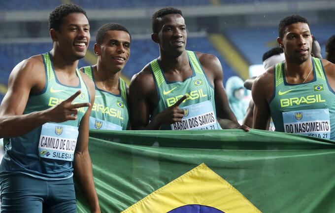 Brazil team members, from left, Paulo Andre Camilo de Oliveira, Derick Silva, Felipe Bardi dos Santos and Rodrigo do Nascimento pose for a photo after the Men's 4x100 Metres Relay final in the Athletics World Relays Championships - Silesia21 in Chorzow, Poland, Sunday, May 2, 2021. (AP Photo /Czarek Sokolowski)