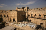 Construction material is ready for use inside the Tower of David Museum in the Old City of Jerusalem, Wednesday, Oct. 28, 2020. Jerusalem's ancient citadel is devoid of tourists due to the pandemic and undergoing a massive restoration and conservation project. (AP Photo/Maya Alleruzzo)