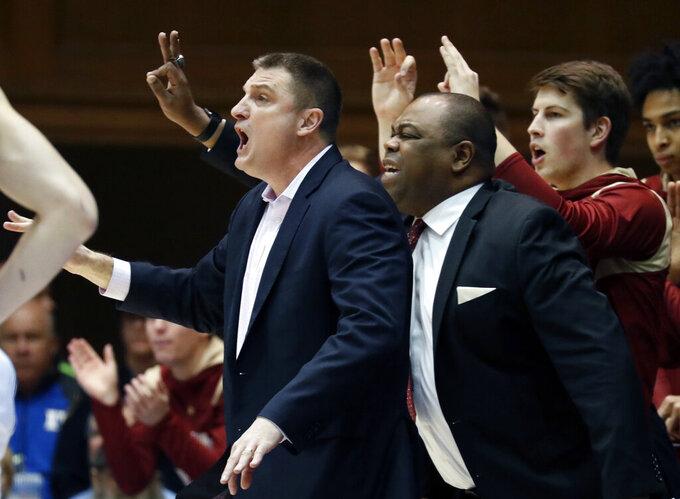 Boston College head coach Jim Christian, left, directs the team the first half of an NCAA college basketball game against Duke in Durham, N.C., Tuesday, Feb. 5, 2019. (AP Photo/Chris Seward)
