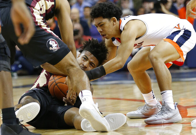 Virginia guard Braxton Key, right, struggles for the ball with Florida State guard David Nichols, left, during the first half of an NCAA college basketball game in Charlottesville, Va., Saturday, Jan. 5, 2019. (AP Photo/Steve Helber)