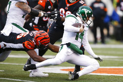 New York Jets quarterback Sam Darnold (14) dives for yardage against Cincinnati Bengals defensive end Carlos Dunlap (96) during the first half of an NFL football game, Sunday, Dec. 1, 2019, in Cincinnati. (AP Photo/Gary Landers)