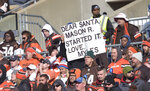 Cleveland Browns fans give their support to Cleveland Browns defensive end Myles Garrett during the first half of an NFL football game against the Miami Dolphins, Sunday, Nov. 24, 2019, in Cleveland. (AP Photo/David Richard)