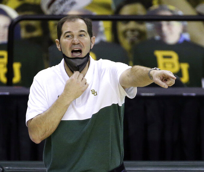 FILE - In this Dec. 30, 2020, file photo, Baylor head coach Scott Drew calls a play to his team in the second half of an NCAA college basketball game against Alcorn State in Waco, Texas. Drew is The AP Big 12 coach of the year, announced Tuesday, March 9, 2021.  (AP Photo/ Jerry Larson, File)