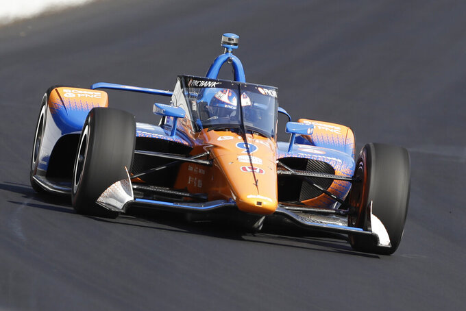 FILE - In this Oct. 2, 2019, file photo, Scott Dixon, of New Zealand, drives into turn one during testing of the new windscreen, at Indianapolis Motor Speedway in Indianapolis. The 2020 IndyCar season will open Saturday night, June 6, 2020, at Texas Motor Speedway. The race will also mark the official race debut of the safety innovation for enhanced driver cockpit protection. The safety feature is a ballistic, canopy-like windscreen anchored by titanium framework encompassing the cockpit. (AP Photo/Darron Cummings, File)