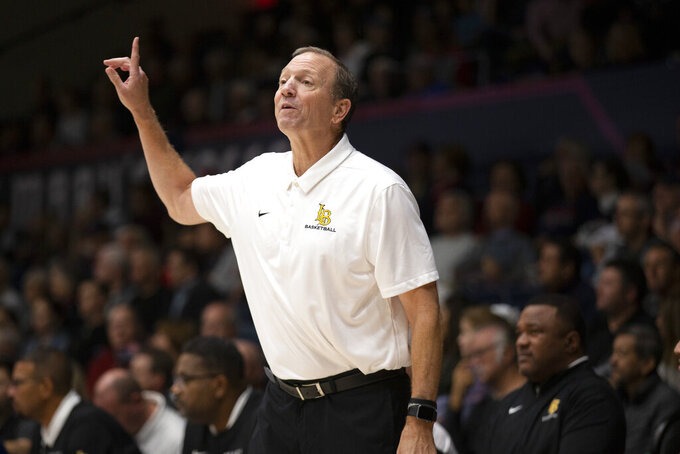 Long Beach State coach Dan Monson signals a play to his team during the first half of an NCAA college basketball game against Saint Mary's, Thursday, Nov. 14, 2019, in Moraga, Calif. (AP Photo/D. Ross Cameron)