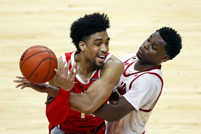 Ohio State forward Justice Sueing, left, is fouled by Rutgers guard Montez Mathis, right, during the second half of an NCAA college basketball game Saturday, Jan. 9, 2021, in Piscataway, N.J. Ohio State won 79-68. (AP Photo/Adam Hunger)