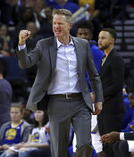 FILE - In this March 14, 2018, file photo, Golden State Warriors coach Steve Kerr gestures in front of Stephen Curry during the second half of the team's NBA basketball game against the Los Angeles Lakers in Oakland, Calif. Kerr understands the NBA's business side, free agency and everything it takes to build a perennial winner with a star-studded roster like the one he gets to coach every day.  He knows what these Warriors have now will hardly last forever (AP Photo/Ben Margot, File)