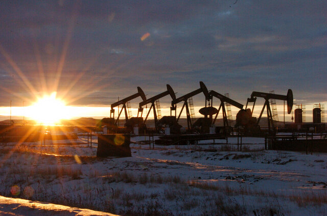 FILE - In this Jan. 14, 2015, file photo, oil pump jacks are seen in McKenzie County, in western North Dakota. The Trump administration is seeking to ease more rules for oil and gas drilling that were adopted under the Obama administration, with the latest changes projected to save energy companies almost $140 million over the next decade. (AP Photo/Matthew Brown, File)