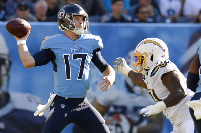 Tennessee Titans quarterback Ryan Tannehill (17) passes as he is pressured by Los Angeles Chargers defensive end Damion Square in the first half of an NFL football game Sunday, Oct. 20, 2019, in Nashville, Tenn. (AP Photo/Mark Zaleski)