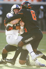 TCU quarterback Max Duggan (15) is brought down by Oklahoma State cornerback Rodarius Williams (8) and defensive end Trace Ford, rear, in the second half of an NCAA college football game in Stillwater, Okla., Saturday, Nov. 2, 2019. (AP Photo/Sue Ogrocki)