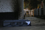 CORRECTS TO STATE THAT THE DECEASED DID NOT DIE OF COVID-19 AND THE CAUSE OF DEATH IS UNKNOWN  - An empty coffin sits outside the crematorium at the San Nicolas Tolentino Pantheon as workers cremate bodies in the Iztapalapa area of Mexico City, Friday, May 22, 2020. Funeral parlors and crematoriums in Iztapalapa, a borough of 2 million people, say they have seen their work multiplied with the surging number of dead of COVID-19 in the capital's hardest-hit corner by the new coronavirus. (AP Photo/Marco Ugarte)