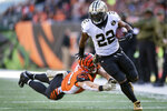 FILE - In this Nov. 11, 2018, file photo, New Orleans Saints running back Mark Ingram (22) outruns the tackle of Cincinnati Bengals defensive end Sam Hubbard (94) during the first half of an NFL football game in Cincinnati. The Baltimore Ravens finally made their move during the NFL's free agent frenzy, securing running back Mark Ingram and safety Earl Thomas on Wednesday, March 13, 2019. (AP Photo/Bryan Woolston, File)