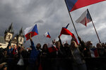 Demonstrators gather to protest against the COVID-19 restrictive measures at Old Town Square in Prague, Czech Republic, Sunday, Oct. 18, 2020. The Czech Republic has imposed a new series of restrictive measures in response to a record surge in coronavirus infections. Among the measures all sports indoor activities are banned and only up to 20 people are allowed to participate in outdoor sport activities also all bars, restaurants and clubs are closed while drinking of alcohol is banned at public places. (AP Photo/Petr David Josek)