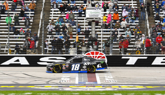 Driver Kyle Busch crosses the finish line to win a NASCAR auto race at Texas Motor Speedway, Saturday, March 30, 2019, in Fort Worth, Texas. (AP Photo/Larry Papke)
