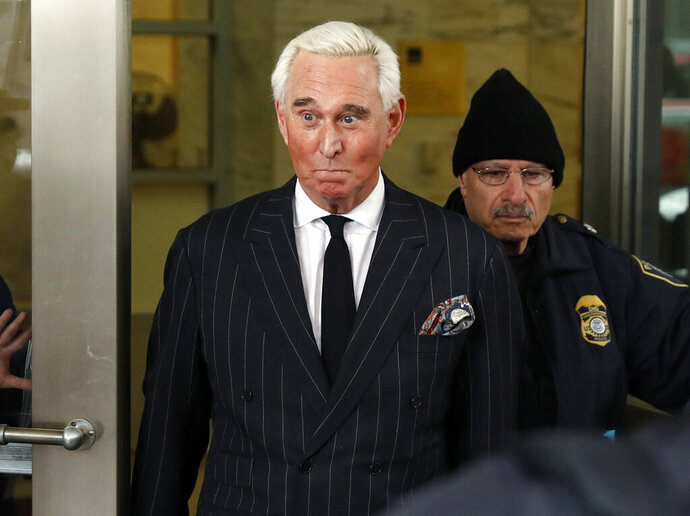 FILE - In this Feb. 1, 2019, file photo, former campaign adviser for President Donald Trump, Roger Stone, leaves federal court in Washington. President Donald Trump's longtime confidant Stone has apologized to the judge presiding over his criminal case for an Instagram post featuring a photo of her with what appears to be the crosshairs of a gun. Stone and his lawyers filed a notice Monday night, Feb. 18, saying Stone recognized