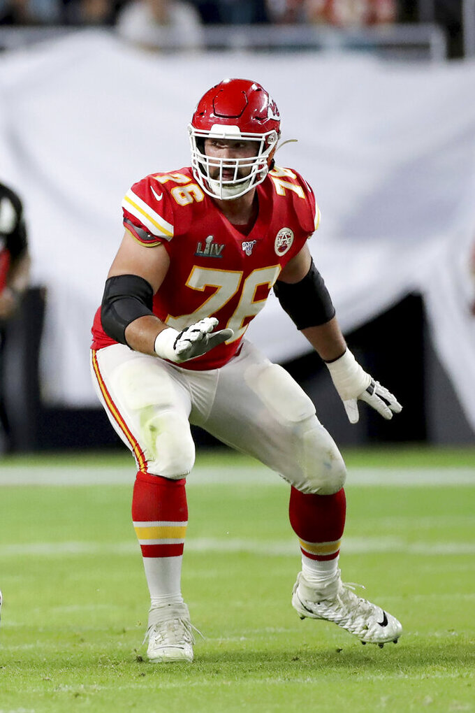 FILE - In this Feb. 2, 2020, file photo, Kansas City Chiefs offensive guard Laurent Duvernay-Tardif (76) blocks against the San Francisco 49ers at Super Bowl 54 in Miami Gardens, Fla. Duvernay-Tardif, of the Super Bowl champion Kansas City Chiefs, became the first player to opt out of the upcoming NFL season due to the coronavirus pandemic, Friday, July 24, 2020. (AP Photo/Gregory Payan, File)