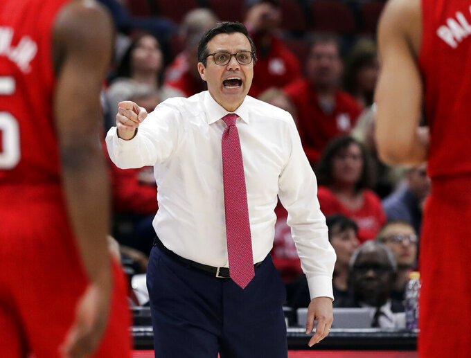Nebraska head coach Tim Miles talks to his team during the first half of an NCAA college basketball game in the first round of the Big Ten Conference tournament against Rutgers in Chicago, Wednesday, March 13, 2019. Nebraska won 68-61. (AP Photo/Nam Y. Huh)