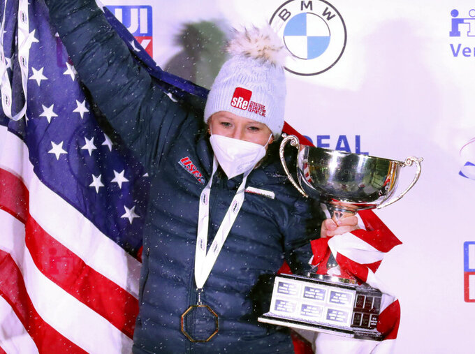 Kaillie Humphries of the United States celebrate after winning with Lolo Jones the two women's bobsleigh race at the Bobsleigh and Skeleton World Championships in Altenberg, Germany, Saturday, Feb. 6, 2021. (AP Photo/Matthias Schrader)