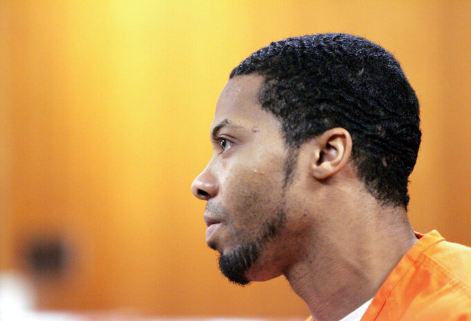 FILE - In this Aug. 23, 2006, file photo, Juwan Deering listens during his sentencing in Oakland County Circuit Court in Pontiac, Mich. Authorities are dropping a murder conviction against Deering, who is serving a life sentence for a fire that killed five children in suburban Detroit in 2000, a prosecutor said Tuesday, Aug. 31, 2021. The case against Deering was spoiled by the failure to share evidence that would have helped his defense, said Oakland County prosecutor Karen McDonald, who was elected last fall. (Richard Lee/Detroit Free Press via AP)