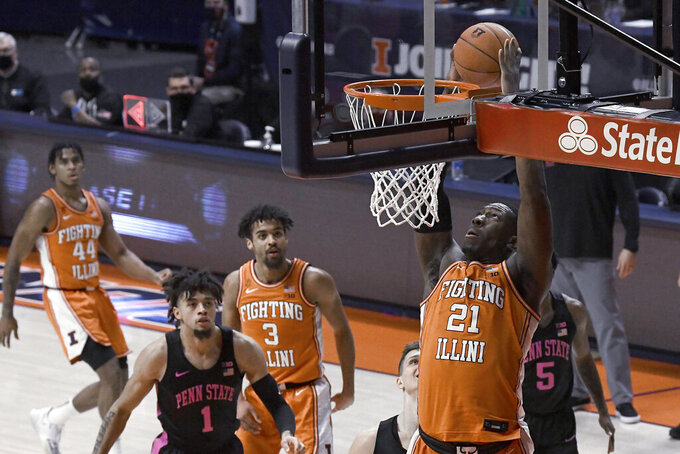 Illinois center Kofi Cockburn (21) dunks against Penn State during the first half of an NCAA college basketball game Tuesday, Jan. 19, 2021, in Champaign, Ill. (AP Photo/Holly Hart)