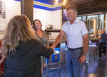 Michael Waltrip greets customers at his newly opened Michael Waltrip Brewing location in downtown Bristol, Va., Wednesday, Sept. 1, 2021. Waltrip admits his personal beer palate was once limited but is now expanding — along with his business interests — and the Twin City is the latest beneficiary. (David Crigger/Bristol Herald Courier via AP)