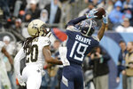 Tennessee Titans wide receiver Tajae Sharpe (19) catches a 7-yard touchdown pass against New Orleans Saints cornerback Janoris Jenkins (20) in the second half of an NFL football game Sunday, Dec. 22, 2019, in Nashville, Tenn. (AP Photo/Mark Zaleski)