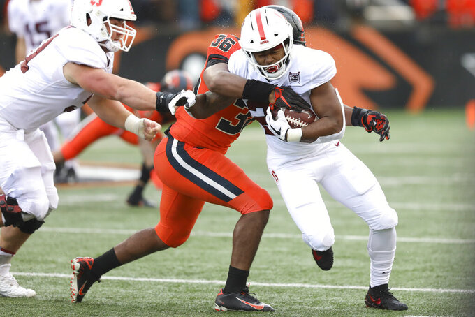 Stanford running back Dorian Maddox, right, slips a tackle from Oregon State inside linebacker Omar Speights (36) during the first half of an NCAA college football game in Corvallis, Ore., Saturday, Sept. 28, 2019. (AP Photo/Amanda Loman)