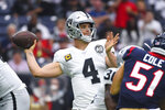 Oakland Raiders quarterback Derek Carr (4) passes against the Houston Texans during the first half of an NFL football game Sunday, Oct. 27, 2019, in Houston. (AP Photo/Eric Christian Smith)