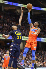 Oklahoma City Thunder's Hamidou Diallo (6) drives to the basket against Cleveland Cavaliers' John Henson (31) in the second half of an NBA basketball game, Saturday, Jan. 4, 2020, in Cleveland. Oklahoma won 121-106. (AP Photo/Tony Dejak)