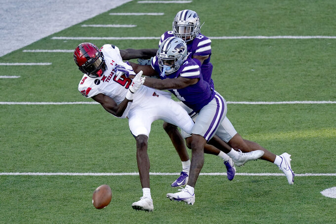 Kansas State defensive back TJ Smith (7) breaks up a pass intended for Texas Tech wide receiver T.J. Vasher (9) during the second half of an NCAA college football game Saturday, Oct. 3, 2020, in Manhattan, Kan. (AP Photo/Charlie Riedel)
