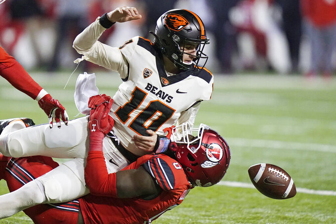 Oregon State quarterback Chance Nolan (10) loses the ball as he is sacked by Utah linebacker Devin Lloyd (0) during the second half of an NCAA college football game Saturday, Dec. 5, 2020, in Salt Lake City. (AP Photo/Rick Bowmer)