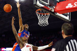 Florida guard Scottie Lewis (23) blocks a shot from Georgia's Anthony Edwards (5) during an NCAA college basketball game Wednesday, March 4, 2020, in Athens, Ga. (Joshua L. Jones/Athens Banner-Herald via AP)