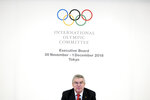 FILE - In this Nov. 30, 2018, file photo, International Olympic Committee (IOC) President Thomas Bach attends an IOC Executive Board meeting in Tokyo Friday, Nov. 30, 2018. Bach has dismissed a new study from the University of Oxford that finds Tokyo is the most expensive Summer Games dating back to 1960. (AP Photo/Eugene Hoshiko, File)