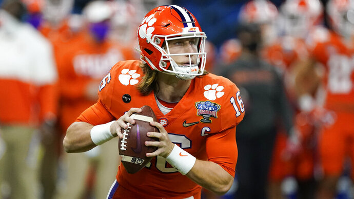 Clemson quarterback Trevor Lawrence passes against Ohio State during the first half of the Sugar Bowl NCAA college football game Friday, Jan. 1, 2021, in New Orleans. (AP Photo/John Bazemore)