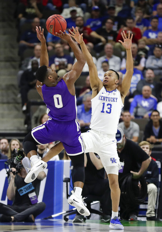 Abilene Christian's Jaylen Franklin (0) shoots over Kentucky's Jemarl Baker Jr. (13) during the first half of a first-round game in the NCAA men's college basketball tournament in Jacksonville, Fla. Thursday, March 21, 2019. (AP Photo/John Raoux)