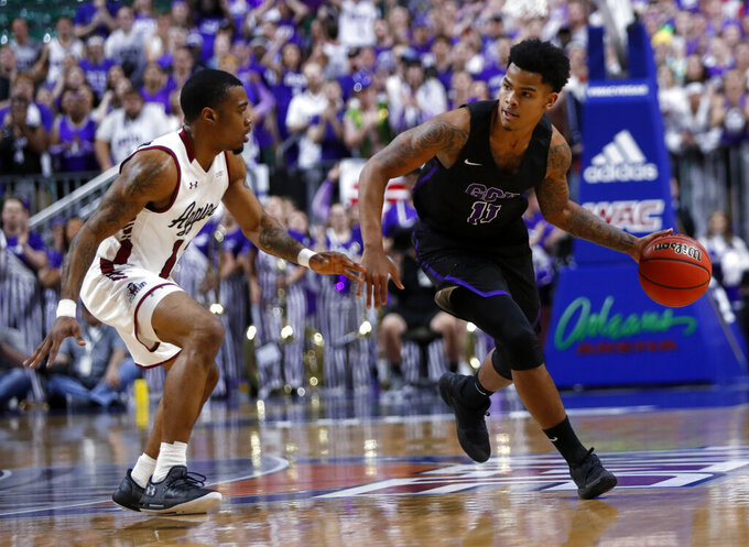 Grand Canyon's Damari Mislead (11) drives by New Mexico State guard AJ Harris (12) during the first half of an NCAA college basketball game for the Western Athletic Conference men's tournament championship Saturday, March 16, 2019, in Las Vegas. (AP Photo/Steve Marcus)